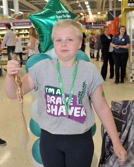Head shave of 10 year old Leah for cancer charity Macmillan Research held at Tesco March. Picture: S