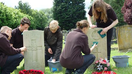 Soham British Legion arrange for local police cadets, Brownies and Guides to clean war graves