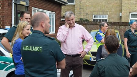 Peter Swann chatting with some of the people who saved his life