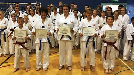 Adults from the Ely school of the Mark Farnham Schools of Tae Kwon-Do after their colour belt gradin