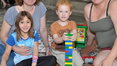 Ely Cathedral holiday drop in session. Children and parents joining in the fun. Picture: Steve Will