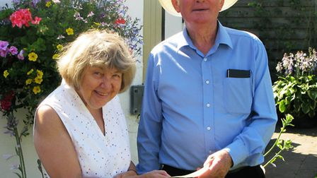 Ely & District Parkinson's UK Support Group secretary, Jenny Lowles presents former head gardener of
