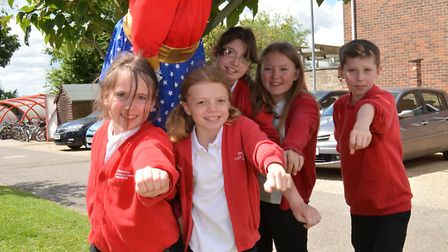 Pupils at Rackham Primary School (l-r) Abi, Phoebe, Senera, Beau, and Patrick, taking part in Witchf