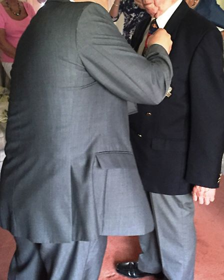 John McIntosh receiving the medal by French Consul Jean-Claude Lafontaine