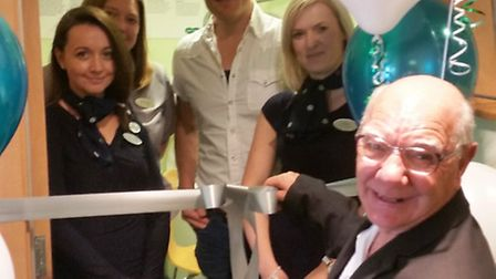 Specsavers' new third room in its March premises is opened by FACET student Jennifer Campbell instor