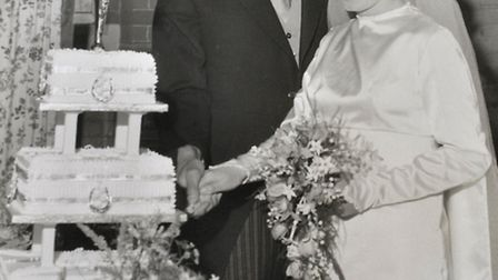 Cutting the cake in 1966. Anthony and Helen Chandler celebrate their 50th wedding anniversaryy - the