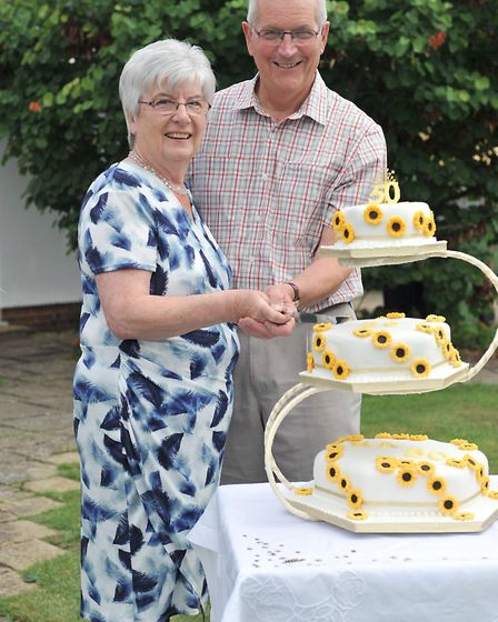 Cutting tuhe cake in 2016. Anthony and Helen Chandler celebrate their 5oth wedding anniversaryy - th