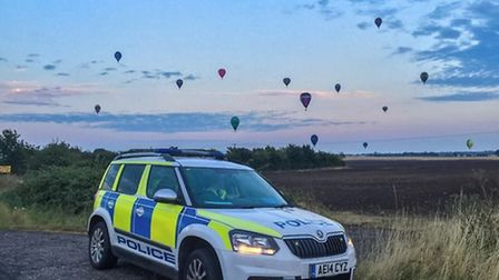 Police posted this atmospheric photo of a Cambs police car with a back drop of balloons taking part