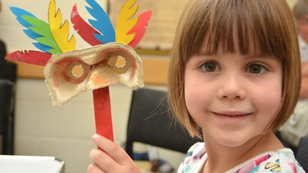Ely Museum craft activity with a Brilliant Birds theme, Sophie from Witchford with her mask