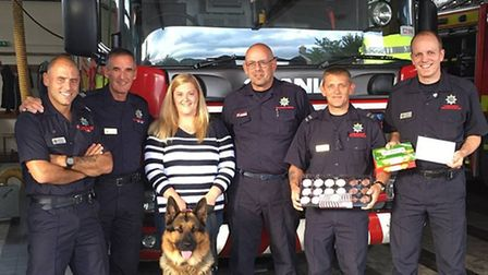 Paddy the dog meets fire crew who rescued him