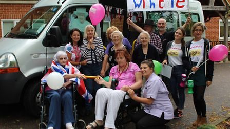 Front Row L-R: Resident at the New Deanery Brenda Boley passing the baton to St Marys Court resident