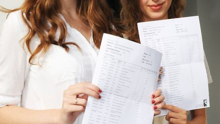 Caitlin Abbey Mae Davis and Rhian Sophie Young with their GCSE results at Cromwell.