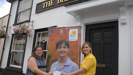 Sharon Alford (left) landlady of The Bell pub in Great Bardfield donates a cheque for £826 to Rose B