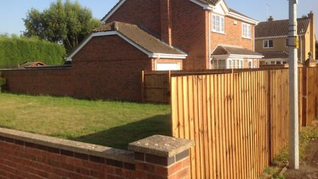 Fenced off: Open play area in Hemmerley Drive, Whittlesey, where residents have been told to expect