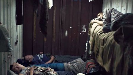 Images of modern slavery from a government video highlighting the issue