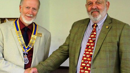 John Dennick (right) hands over chain of office to Phil Smith