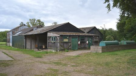 Some of the disused barns that will be demolished to make way for the brewery.