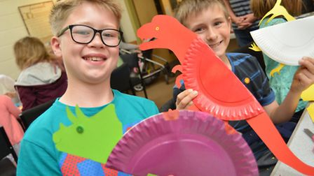 Ely Museum Dynamic Dinosaurs: (l-r) Ollie and Thomas with their dinosaurs.