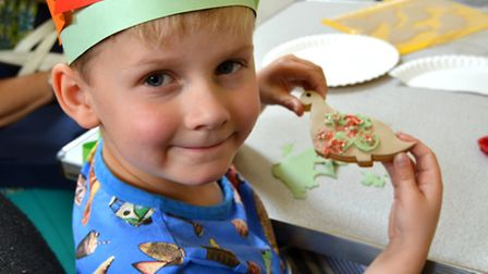 Ely Museum Dynamic Dinosaurs: Henry with his dinosaur biscuit.