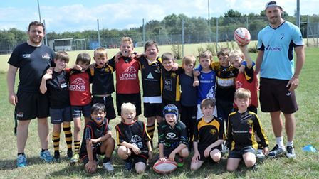Coach Jamie Capon (first left) with the under 9s and Patrick Tapley (first right). Picture: Steve Wi