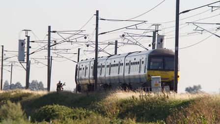 A man was airlifted to hospital after his car was hit by a train. Stretham Level Crossing. Picture b