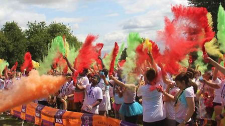 Runners cover themselves in paint in the Colour Dash's grande finale - the paint party.