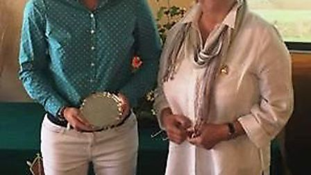Laura Todd receives the Scratch Salver trophy from Ladies captain, Eve Mairr.