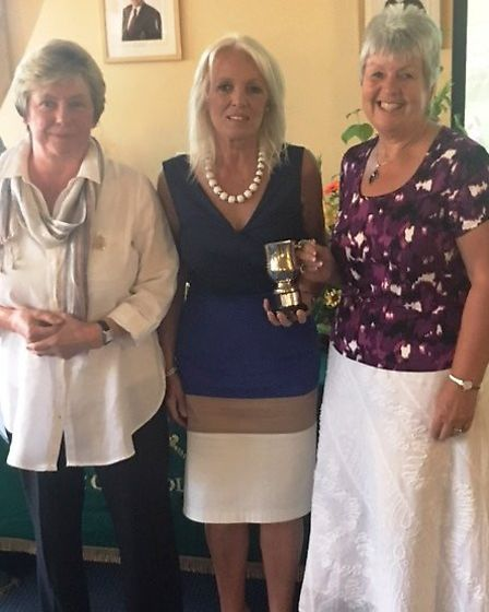 Vivienne Parr and Anne Webster receiving their trophies from Ladies captain, Eve Mairr.