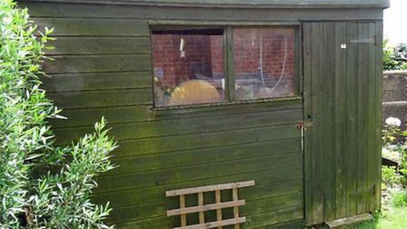 Shed situated to the side of the house, adjacent to Cannon Street. The external height is 2.20 meter