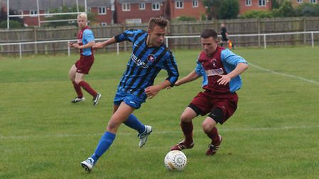 Action from Whittlsey Athletic's 4-1 loss to Long Buckby. Picture: Andrew Hazelden