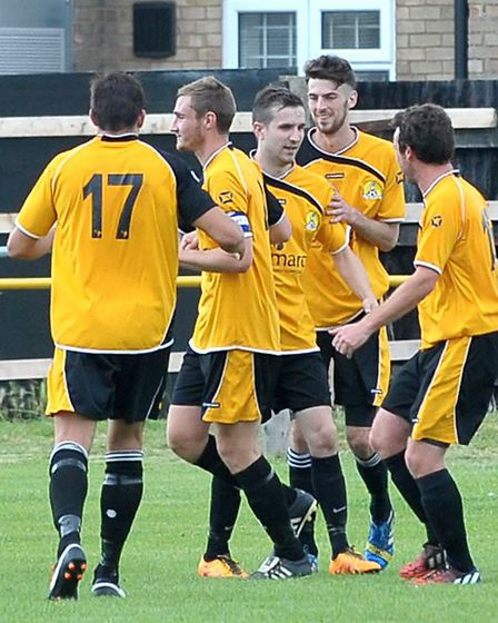 March Town celebrate one of their three goals. Picture: Steve Williams