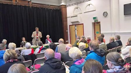 Campaigners discuss the future of Fenland's NHS services at a public meeting.