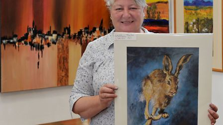 Ely Art Society exhibition held at Hayward Theatre, Ely. Yvonne Welsh with her acrylic painting titl