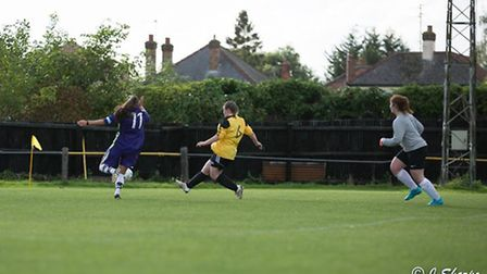 Louise Barbour rounds the 'keeper the give March Town Ladies a 2-0 lead. Photo: Jon Sharpe
