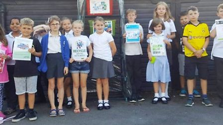 Members of the Junior Youth Club with the public access AEROCYCLE collection box and some of the emp