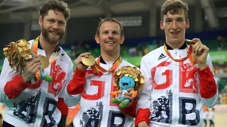 Great Britain's Jon-Allan Butterworth, Jody Cundy and Louis Rolfe (right) celebrate with their gold