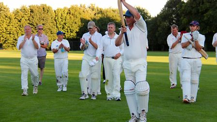 Simon Bradshaw leaves the pitch after captaining his side to victory. Photo: Catherine Henshaw