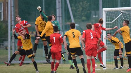 Yarmouth goalkeeper, Elvijs Putnins, punches the ball away. Picture: DENISE BRADLEY