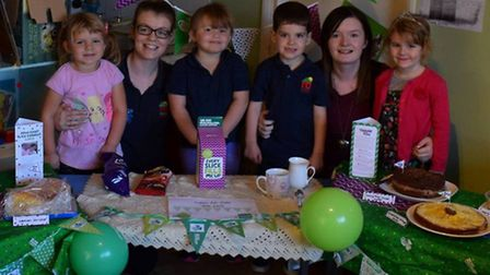 Children and staff at Clarence House Chatteris holding a coffee morning for Macmillan.