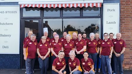 Gorefield Short Mats Bowls Club proudly showing the new club shirts courtesy of sponsorship from Gor