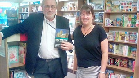 Mike Rouse with Annabel Reddick of Burrow's Bookshop at the launch of The Story of Ely.