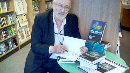 Mike Rouse signing copies of The Story of Ely.