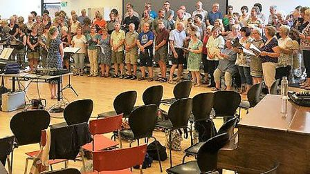 The choirs rehearsing together.