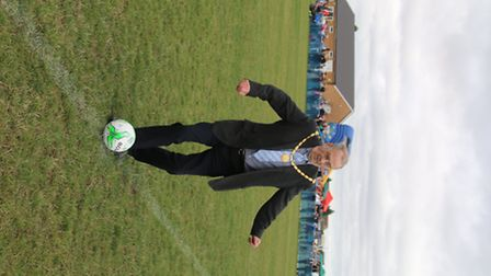 Mayor Councillor Alex Miscandlon kicks off a charity football match in Whittlesey raising funds for