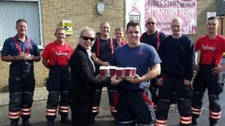 March firefighters scrub up nicely, raising hundreds for charity.