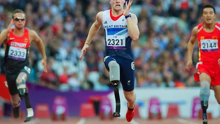 Jonnie Peacock, pictured here at the London 2012 Games, eased through the T44 100m heats in Rio de J