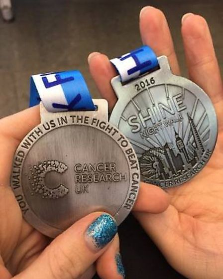 Cara and Daisy's medals.