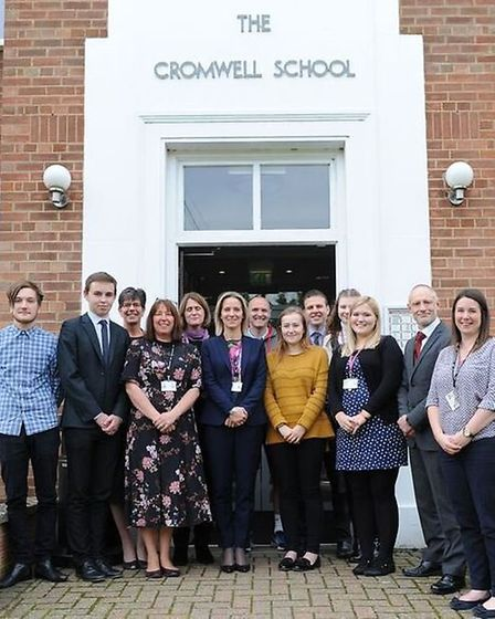 Staff outside the front of Cromwell Community College, Chatteris.