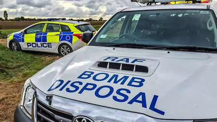 Bomb disposal team carry out controlled explosion on suspected World War Two mortar in March Road, C