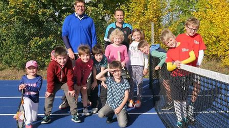 Danny Sapsford (centre) with children who took part in the coaching at Ely Tennis Club.